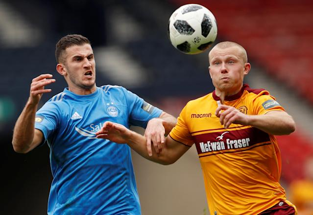 Soccer Football - Scottish Cup Semi-Final - Motherwell vs Aberdeen - Hampden Park, Glasgow, Britain - April 14, 2018 Aberdeen's Dominic Ball in action with Motherwell's Curtis Main Action Images via Reuters/Lee Smith