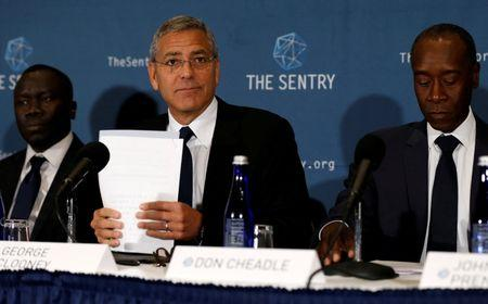 Clooney, with  Cheadle and Adeba, discuss The Sentry's investigation of the role of national corruption in the ongoing humanitarian crisis in South Sudan during a news conference at the National Press Club in Washington, U.S.