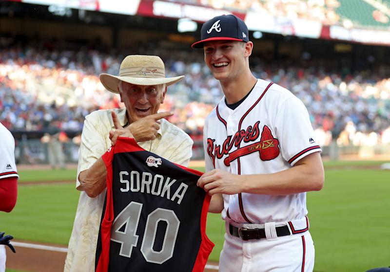 Jul 2, 2019; Atlanta, GA, USA; Atlanta Braves starting pitcher Mike Soroka (40) is honored with his All-Star jersey by Braves former pitcher Phil Niekro (left) before a game against the Philadelphia Phillies at SunTrust Park. Mandatory Credit: Jason Getz-USA TODAY Sports