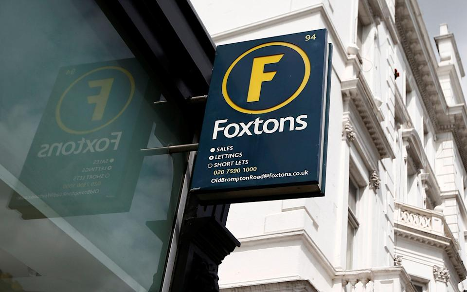 A Foxtons estate agent sign is seen outside a branch in west London - Peter Nicholls/REUTERS