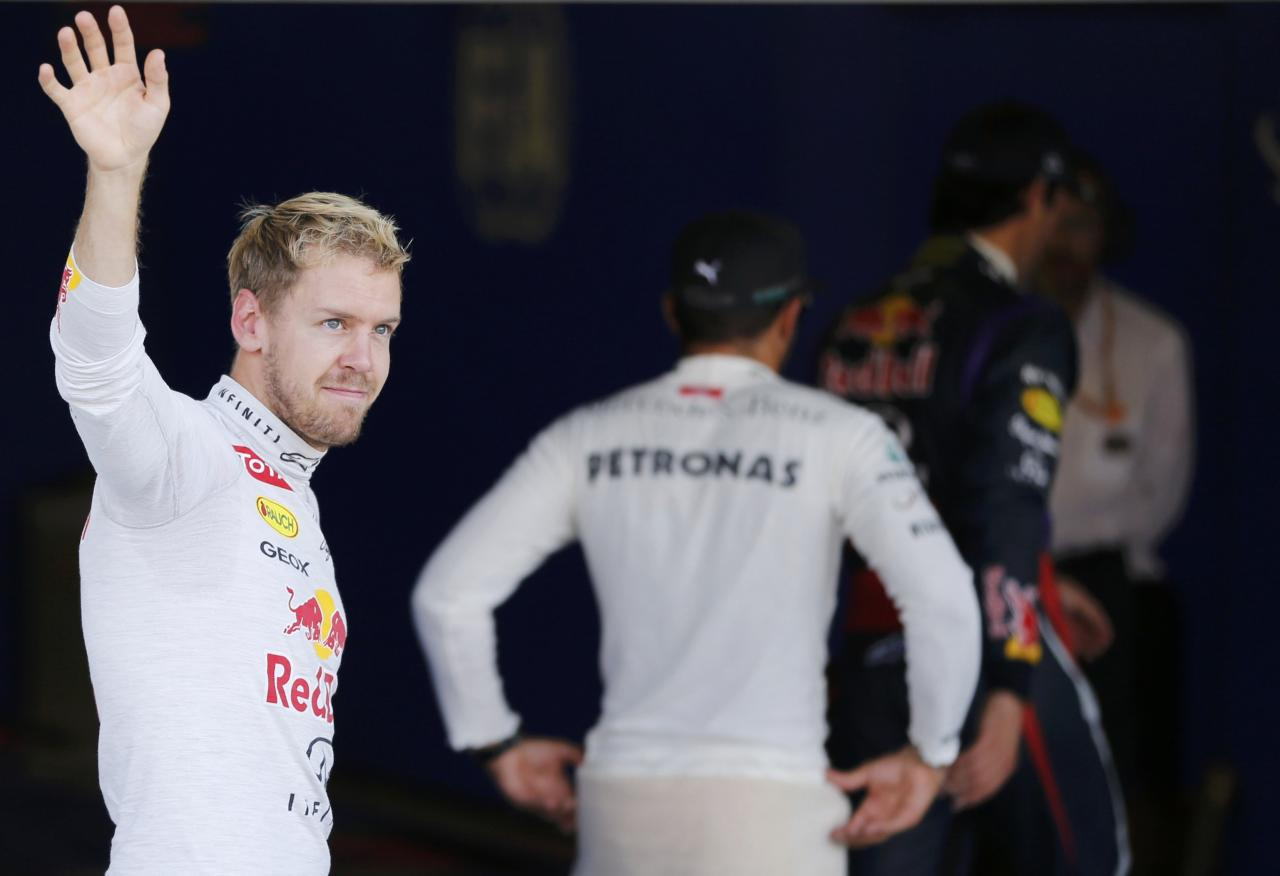 Red Bull Formula One driver Sebastian Vettel of Germany wave after the qualifying session of the Japanese F1 Grand Prix at the Suzuka circuit October 12, 2013. REUTERS/Issei Kato (JAPAN - Tags: SPORT MOTORSPORT F1)