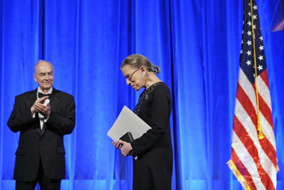 Former Sen. Harris Wofford, left, applauds as Supreme Court Associate Justice Ruth Bader Ginsburg leaves the stage after being awarded a Jefferson Award for Public Service. (Photo: Cliff Owen/AP)