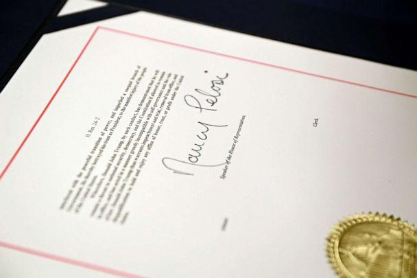 PHOTO: The signature of Speaker of the House Nancy Pelosi is seen on the article of impeachment during an engrossment ceremony after the House of Representatives voted to impeach President Trump, at the U.S. Capitol in Washington, Jan. 13, 2021. (Brendan Smialowski/AFP via Getty Images)