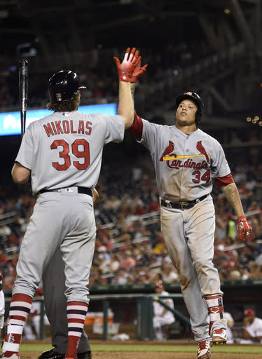 St. Louis Cardinals' Yairo Munoz (34) celebrates his home run with Miles Mikolas (39) during the sixth inning of a baseball game against the Washington Nationals, Wednesday, Sept. 5, 2018, in Washington. (AP Photo/Nick Wass)