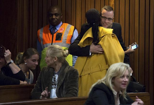 Oscar Pistorius, top right, is greeted by a supporter on his arrival in court for his ongoing murder trial in Pretoria, South Africa, Tuesday, May 13, 2014. Pistorius is charged with the shooting death of his girlfriend Reeva Steenkamp on Valentine's Day in 2013. (AP Photo/Daniel Born, Pool)