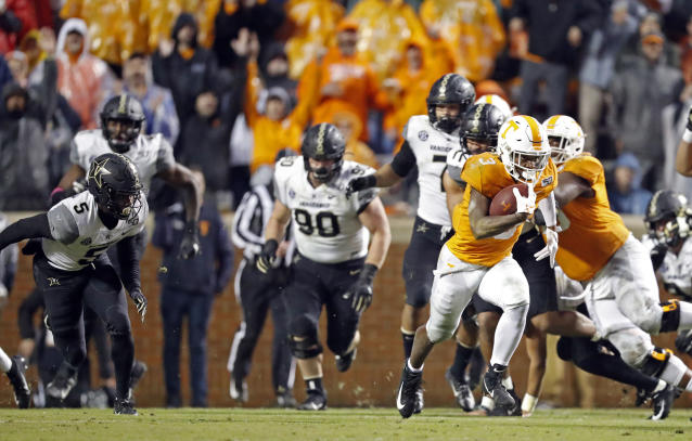 Tennessee running back Eric Gray (3) gets past the Vanderbilt defense en route to a 94-yard touchdown in the first half of an NCAA college football game Saturday, Nov. 30, 2019, in Knoxville, Tenn. (AP Photo/Wade Payne)