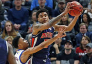 <p>Kansas guard Devon Dotson, left, guards Auburn forward Chuma Okeke during the first half of a second-round game in the NCAA men's college basketball tournament Saturday, March 23, 2019, in Salt Lake City. (AP Photo/Rick Bowmer) </p>