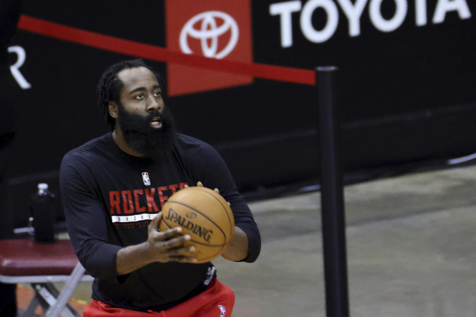 Houston Rockets' James Harden warms up prior to an NBA basketball game against the Los Angeles Lakers, Sunday, Jan. 10, 2021, in Houston. (Carmen Mandato/Pool Photo via AP)