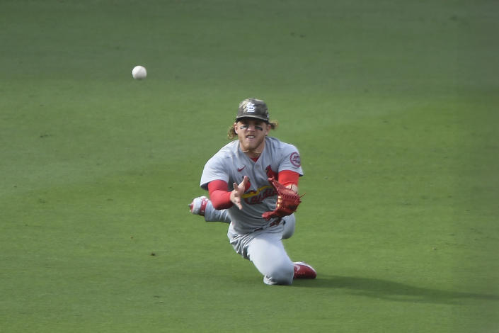 St. Louis Cardinals center fielder Harrison Bader can't make the catch on a single hit by San Diego Padres' Austin Nola during the fourth inning of a baseball game Sunday, May 16, 2021, in San Diego. (AP Photo/Denis Poroy)