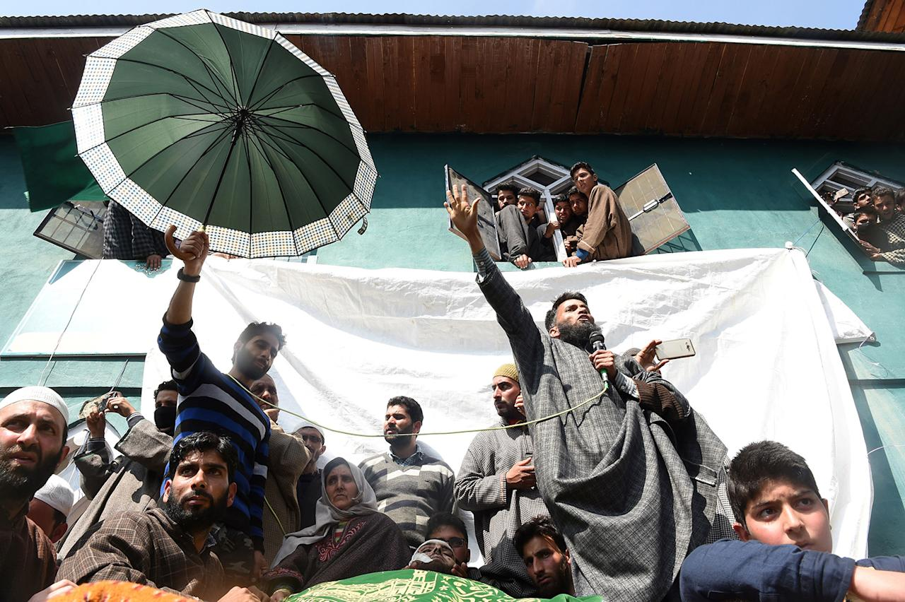 <p>People shout pro-independence slogans at the funeral of a local suspected rebel commander Tauseef Ahmed Wagay at Yaripora, south of Srinagar, Indian controlled Kashmir, Wednesday, March 29, 2017. (Tauseef Mustafa/AFP/Getty Images) </p>