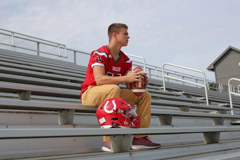 Maison Hullibarger, who died suddenly on Dec. 4, 2018, sits in the stands of Bedford High School in Temperance, Mich.