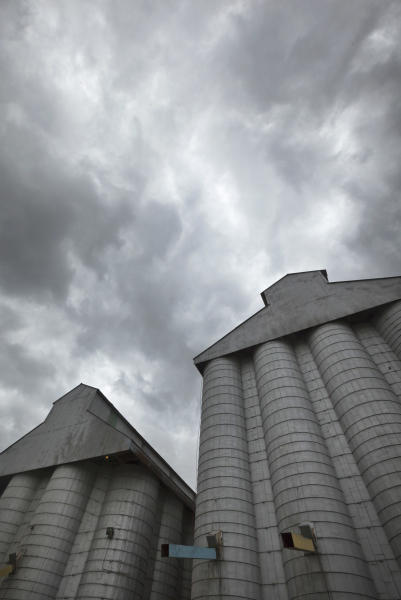 Storm clouds leading remnants of Hurricane Isaac gather in the skies over a grain elevator in England, Ark., Thursday, Aug. 30, 2012. With the storms approaching many farm states, some farmers wonder whether too much relief is on the horizon. (AP Photo/Danny Johnston)