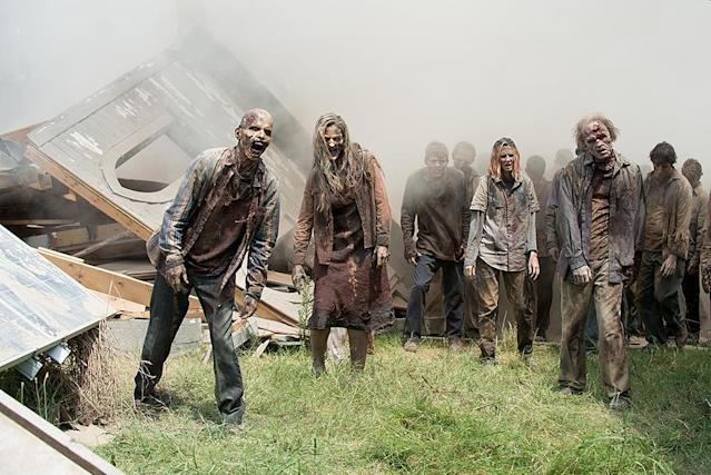 "<p>The characters in the show never utter the word ""zombie"" — the undead are always called ""walkers"" or something else. But the comics characters do occasionally use the z-word. Kirkman has said he avoids the word because the <em>Walking Dead</em> universe is one in which zombie movies and fiction don't exist.<br><br>(Photo Credit: Gene Page/AMC) </p>"