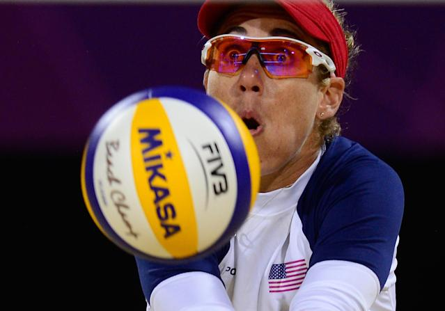 April Ross from the US controls the ball during the women's Beach Volleyball semi-final against Brazil's Larissa Franca and Juliana Silva on The Centre Court Stadium on Horse Guards Parade in London on August 7, 2012, for the London 2012 Olympic Games. USA won 2-1 AFP PHOTO / DANIEL GARCIADANIEL GARCIA/AFP/GettyImages