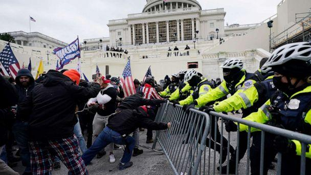 PHOTO: Trump supporters try to break through a police barrier, Jan. 6, 2021, at the Capitol in Washington. (Julio Cortez/AP)