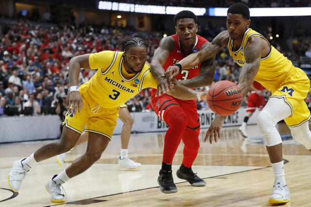 <p>DeShawn Corprew #3 of the Texas Tech Red Raiders fights for the ball against Zavier Simpson #3 and Charles Matthews #1 of the Michigan Wolverines during the 2019 NCAA Men's Basketball Tournament West Regional at Honda Center on March 28, 2019 in Anaheim, California. (Photo by Sean M. Haffey/Getty Images) </p>