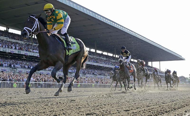 Palace Malice, left, ridden by jockey Mike Smith, crosses the finish line to win the 145th Belmont Stakes horse race at Belmont Park Saturday, June 8, 2013, in Elmont, N.Y. (AP Photo/Julio Cortez)