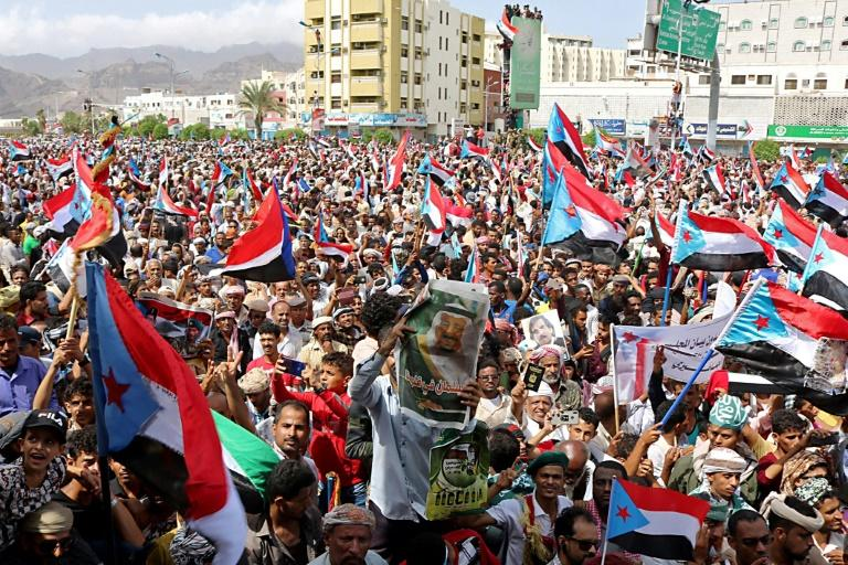 Supporters of separatists wave flags of the former South Yemen in the southern port city of Aden