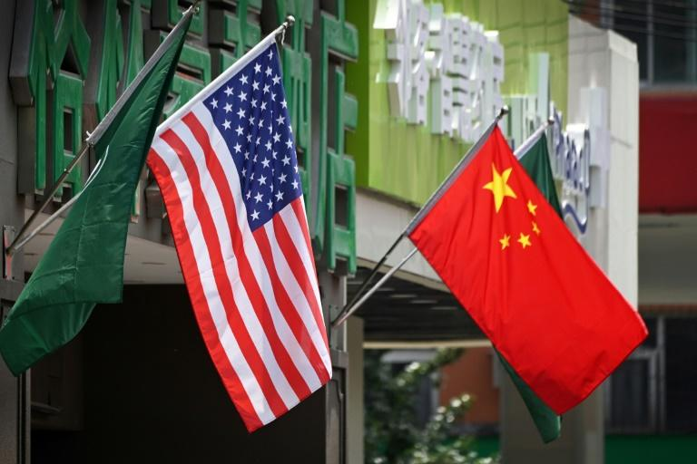 Analysts have warned that the impact of the ongoing trade war between China and the US has not been confined to just their economies (AFP Photo/Greg Baker)