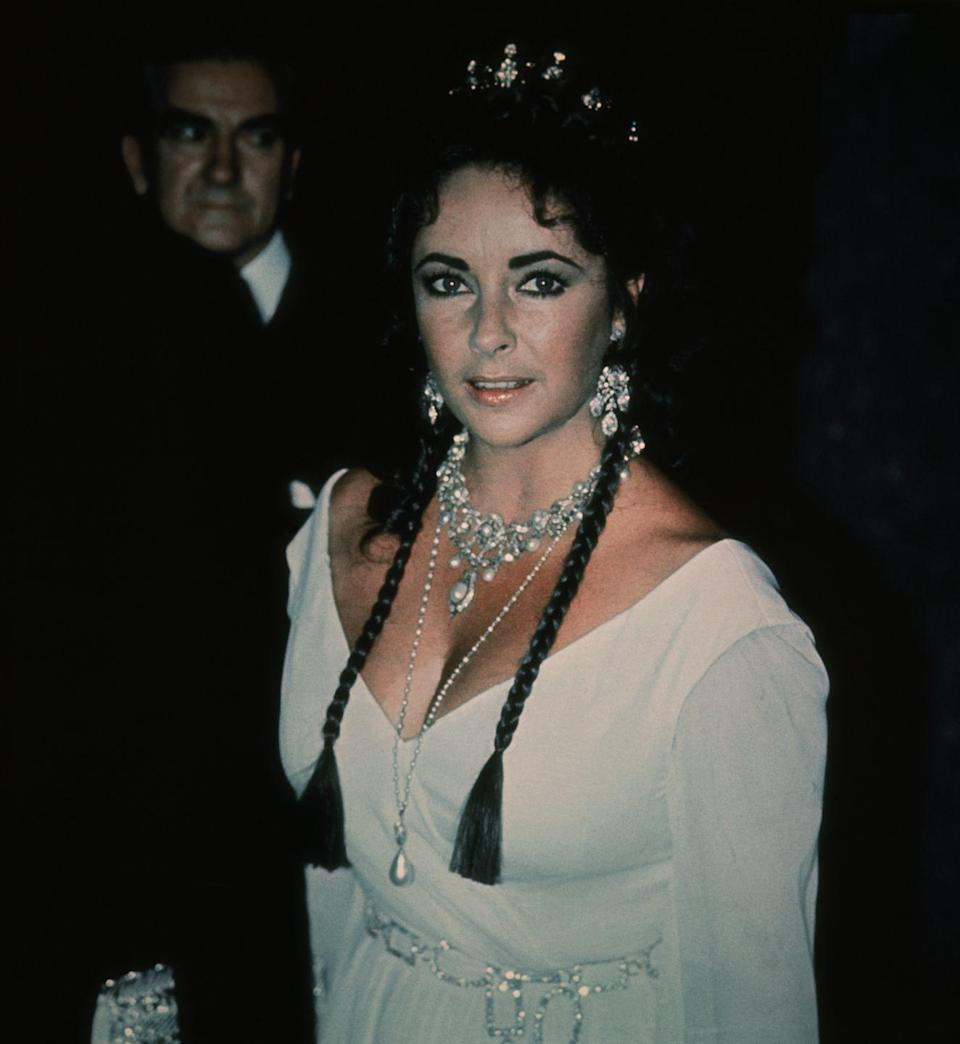 <p>Elizabeth Taylor drips in diamonds at the film premiere of <em>Staircase</em> in 1969. </p>