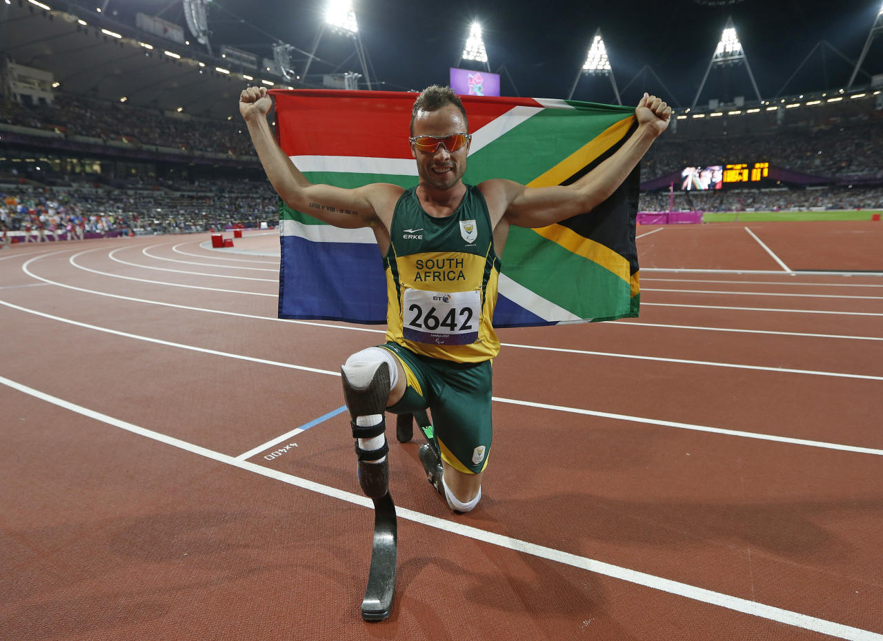 South Africa's Oscar Pistorius celebrates winning the Men's 400m T44 classification at the Olympic Stadium during the London 2012 Paralympic Games September 8, 2012  REUTERS/Eddie Keogh (BRITAIN - Tags: SPORT OLYMPICS ATHLETICS) - RTR37PB3