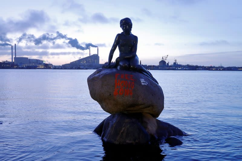 """Denmark's most famous landmark, 'The Little Mermaid', is seen after unknown culprits wrote """"Free Hong Kong"""" with graffiti on the sculpture, in Copenhagen"""
