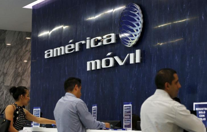 The America Movil logo is seen at the reception area in the company's offices in Mexico City