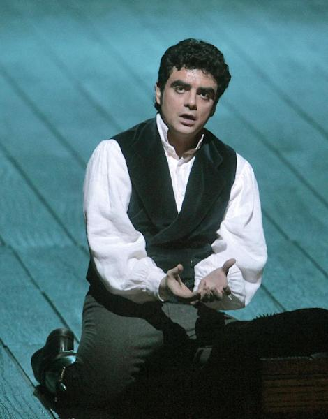 """FILE - In this Jan. 26, 2009 file photo provided by the Metropolitan Opera, Rolando Villazon performs as Edgardo in """"Lucia di Lammermoor"""" at the Metropolitan Opera in New York. Villazon returns to Metropolitan Opera singing five performances, starting Saturday, Nov. 23, 2013, as the headstrong poet Lenski in a new production of Tchaikovsky's """"Eugene Onegin.""""(AP Photo/Metropolitan Opera, Ken Howard, File)"""