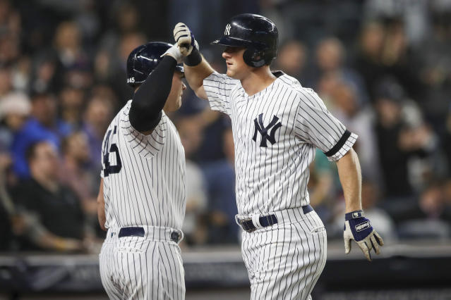 New York Yankees' DJ LeMahieu celebrates with Luke Voit after hitting a three run home run during the second inning of a baseball game against the Los Angeles Angels, Thursday, Sept. 19, 2019, in New York. (AP Photo/Mary Altaffer)