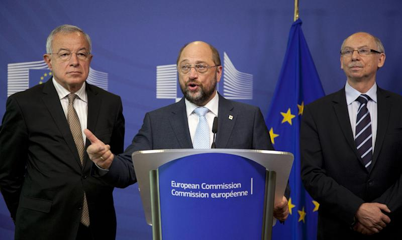 European Parliament President Martin Schultz, center, speaks during a media conference at EU headquarters in Brussels on Thursday, June 27, 2013. The European Union may soon have a new seven-year budget after a surprise breakthrough deal was announced Thursday morning. European Commission President Jose Manuel Barroso announced the agreement Thursday after late-night talks with the president of the European Parliament and other officials from EU member states. Barroso said it includes more flexibility than earlier versions. (AP Photo/Virginia Mayo)
