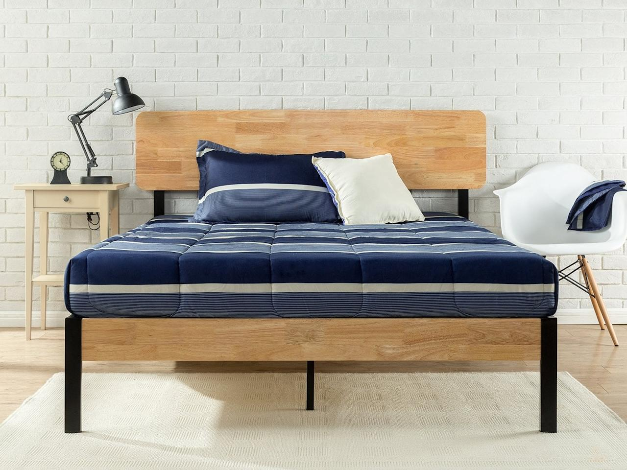 "<p>Looking for a simple and chic bed frame? Get this <a href=""https://www.popsugar.com/buy/Zinus%20Olivia%20Metal%20and%20Wood%20Platform%20Bed-472017?p_name=Zinus%20Olivia%20Metal%20and%20Wood%20Platform%20Bed&retailer=amazon.com&price=160&evar1=casa%3Aus&evar9=46417524&evar98=https%3A%2F%2Fwww.popsugar.com%2Fhome%2Fphoto-gallery%2F46417524%2Fimage%2F46417913%2FZinus-Olivia-Metal-Wood-Platform-Bed&list1=shopping%2Cfurniture%2Cbedrooms%2Chome%20shopping&prop13=mobile&pdata=1"" rel=""nofollow"" data-shoppable-link=""1"" target=""_blank"" class=""ga-track"" data-ga-category=""Related"" data-ga-label=""https://www.amazon.com/Zinus-Tuscan-Metal-Platform-Support/dp/B06WWF1P78/ref=sr_1_83?keywords=bed%2Bframe%2Bunder%2B%24250&amp;qid=1563994036&amp;s=gateway&amp;sr=8-83&amp;th=1"" data-ga-action=""In-Line Links"">Zinus Olivia Metal and Wood Platform Bed</a> ($160).</p>"