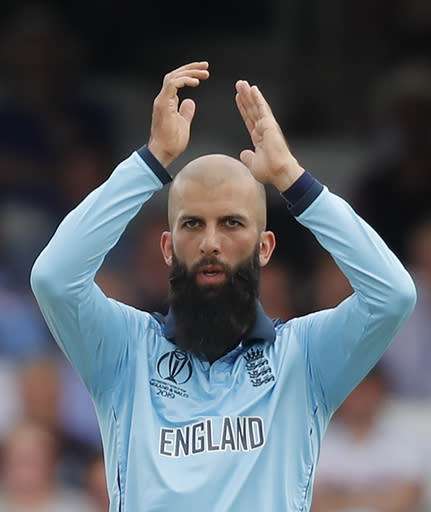 FILE - In this Thursday, May 30, 2019, file photo, England's Moeen Ali reacts as South Africa's Rassie van der Dussen is dropped during their Cricket World Cup match at the Oval in London. Team allrounder Ali was isolating in Sri Lanka on Monday, Jan. 4, 2021, after testing positive for the coronavirus upon his arrival in the South Asian country for the team's two-test cricket tour. (AP Photo/Frank Augstein, File)