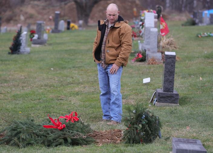 "Frank ""Keith"" Malinowski visits a gravesite in Doylestown, Ohio."