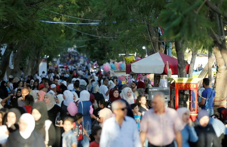 Syrians attend a government-sponsored summer festival in the capital Damascus, on July 11, 2018