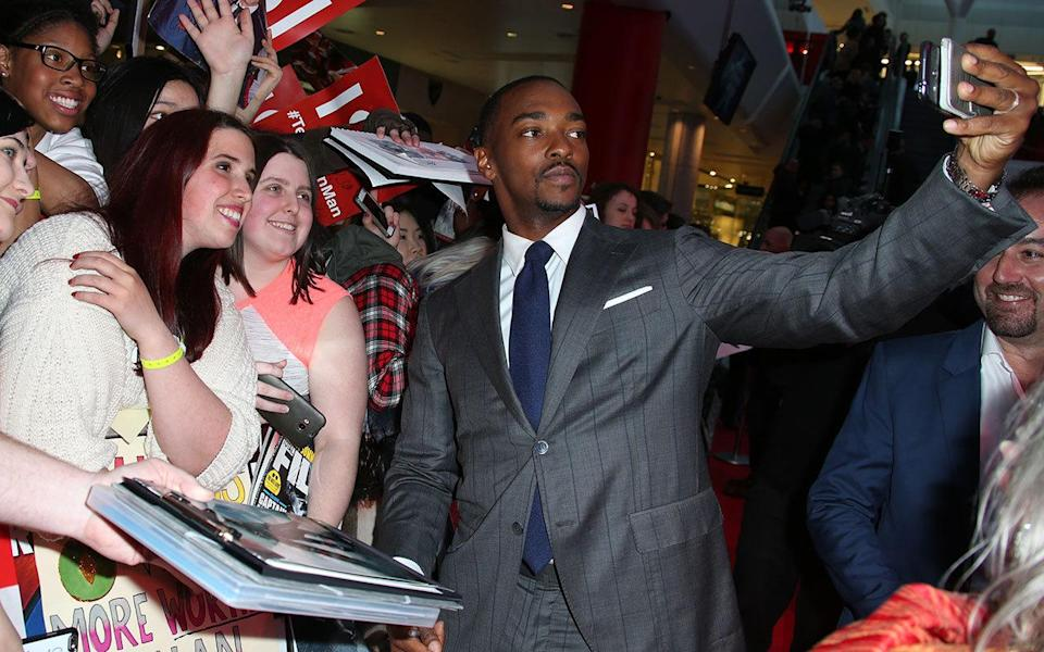 Anthony Mackie (Falcon) helps a fan take a superselfie. Credit: PA