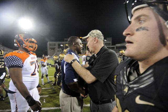 Morgan State head coach Donald Hill-Eley congratulates coach Rich Ellerson after Army won 28-12 during a NCAA college football game Friday, Aug. 30, 2013, in West Point, N.Y. (AP Photo/Hans Pennink)
