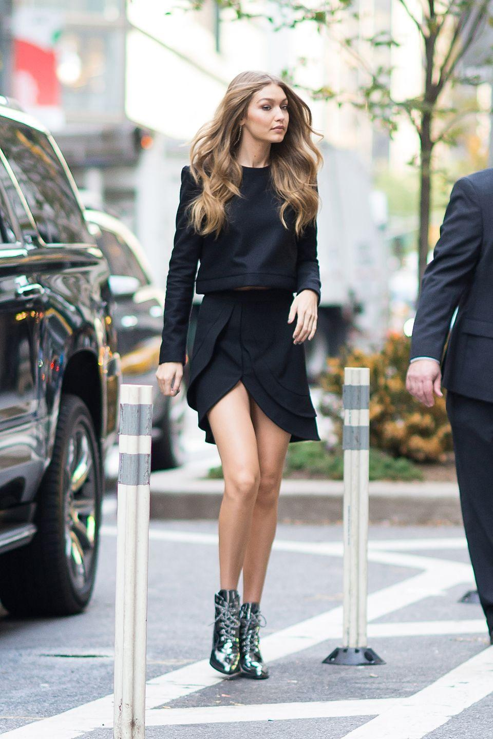 <p>In the silver metallic style of her Gigi boot for Stuart Weitzman, a black cashmere sweater and layered asymmetrical skirt by Brandon Maxwell while heading to her Victoria's Secret fitting. </p>
