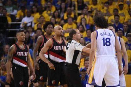 May 1, 2016; Oakland, CA, USA; Portland Trail Blazers guard Gerald Henderson (9, left) argues with Golden State Warriors forward Anderson Varejao (18) during the third quarter in game one of the second round of the NBA Playoffs at Oracle Arena. Kyle Terada-USA TODAY Sports