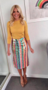 """<p>After her Ashish dress sent social media into a spin, Holly opted for another rainbow-inspired get-up. This time, the presenter looked to <a rel=""""nofollow noopener"""" href=""""https://www.anthropologie.com/en-gb/shop/brix-sequined-palette-skirt?category=skirts&color=066"""" target=""""_blank"""" data-ylk=""""slk:Anthropology"""" class=""""link rapid-noclick-resp"""">Anthropology</a> for a splash of sartorial colour and we cannot get enough. </p>"""