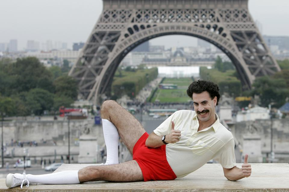"** FILE ** British actor Sacha Baron Cohen, dressed in his character ""Borat"" poses for the press near the Eiffel tower in Paris, in this, Oct. 9, 2006, file photo. Cohen tells The Daily Telegraph that he's retiring the clueless Kazakh journalist, as well as his alter ego, aspiring rapper Ali G.  ""When I was being Ali G and Borat I was in character sometimes 14 hours a day and I came to love them, so admitting I am never going to play them again is quite a sad thing,"" the 36-year-old actor-comedian says in the British newspaper's edition on Friday, Dec. 21, 2007.  (AP Photo/Christophe Ena, file)"