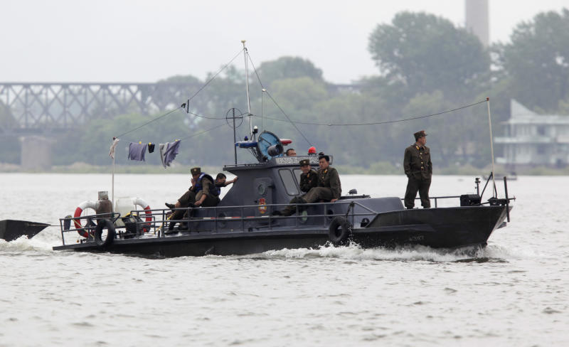 """FILE - In this May 29, 2010 file photo, a North Korean patrol boat makes its way along the Yalu river near Dandong in northeastern China's Liaoning province. China's leadership is hitting a rough patch with ally North Korea under its new leader Kim Jong Un, as Beijing finds itself wrong-footed in episodes including Pyongyang's rocket launch and the murky detention of Chinese fishing boats. """"The North Koreans are like bandits and robbers,"""" China's Southern Metropolis Weekly newspaper quoted one fisherman as saying Tuesday, May 22, 2012. The story said the hijackers ripped down the Chinese flag on one boat and used it """"like a rag."""" (AP Photo/Ng Han Guan, File)"""