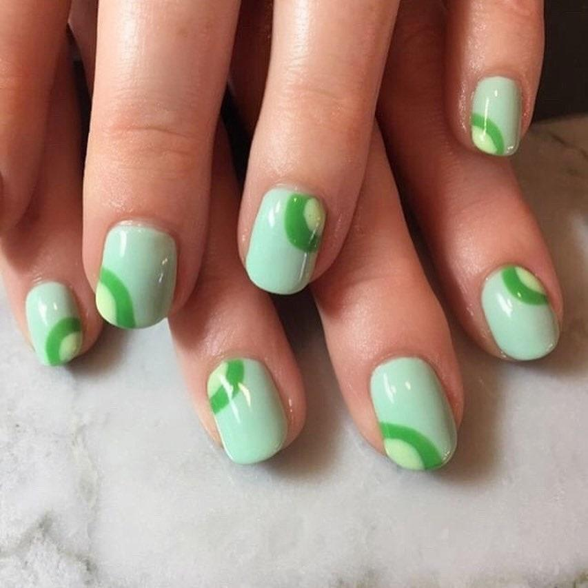 """If abstract is more your thing, this design hints at a Christmas tree without being too literal. Try varying shades of green like Nailtopia in <a href=""""https://shop-links.co/1724786888008706487"""" rel=""""nofollow noopener"""" target=""""_blank"""" data-ylk=""""slk:Yacht Week"""" class=""""link rapid-noclick-resp"""">Yacht Week</a> and <a href=""""https://shop-links.co/1724786900315127723"""" rel=""""nofollow noopener"""" target=""""_blank"""" data-ylk=""""slk:Juice Cleanse"""" class=""""link rapid-noclick-resp"""">Juice Cleanse</a>."""