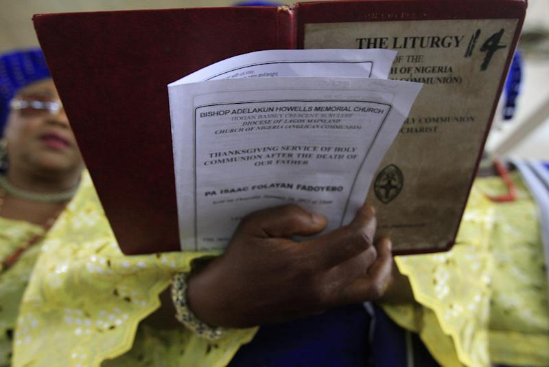 """A woman sings at a church service for the late Isaac Fadoyebo, in Lagos, Nigeria, on Thursday, Jan. 24, 2013. Fadoyebo, who died in November at the age of 86, represents one of the last so-called """"Burma Boys"""" still living through West and East Africa. On Thursday, his family and friends gathered for a final worship service and celebration of his life, as new attention has been paid to his sacrifices and those of other Africans drawn into the fighting. (AP Photo/Jon Gambrell)"""