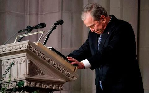 Former US President George W. Bush speaks at the State Funeral for his father, former US President George H W Bush - Credit: ALEX BRANDON/AFP