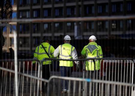 FILE PHOTO - Contractors walk inside Carillion's Royal Liverpool Hospital site in Liverpool