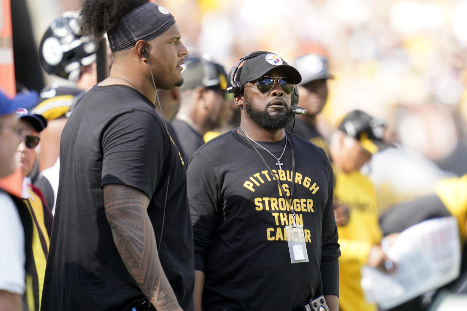 Pittsburgh Steelers head coach Mike Tomlin, right, and Zach Banner stand on the sideline during the second half of an NFL football game against the Denver Broncos in Pittsburgh, Sunday, Oct. 10, 2021. (AP Photo/Keith Srakocic)