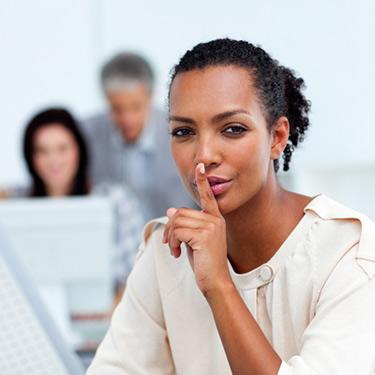 Businesswoman-with-finger-over-mouth_web