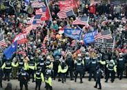 Trump supporters clash with police and security forces as they storm the US Capitol in Washington