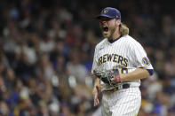 Milwaukee Brewers' Corbin Burnes reacts after striking out a batter during the seventh inning of a baseball game against the New York Mets Saturday, Sept. 25, 2021, in Milwaukee. (AP Photo/Aaron Gash)