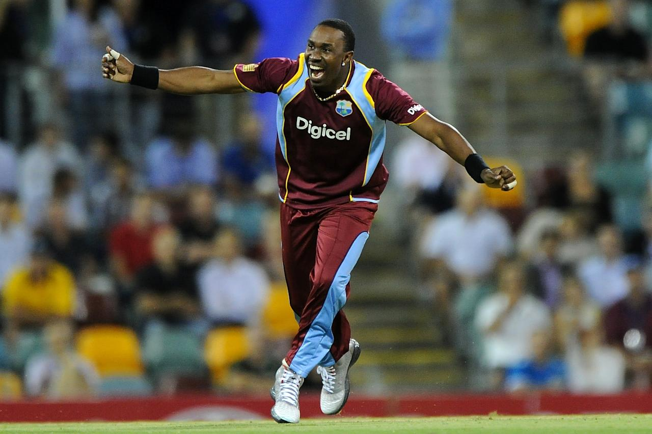 BRISBANE, AUSTRALIA - FEBRUARY 13:  Dwayne Bravo of the West Indies celebrates a wicket during the International Twenty20 match between Australia and the West Indies at The Gabba on February 13, 2013 in Brisbane, Australia.  (Photo by Matt Roberts/Getty Images)